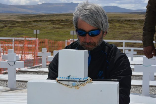Julio Aro in the Argentine Military Cemetery (or Darwin Cemetery), in Malvinas/Falkland Islands. The former combatant worked since 2008 with the aim of identifying the Argentine soldiers buried on the islands. Credit: Courtesy of Julio Aro