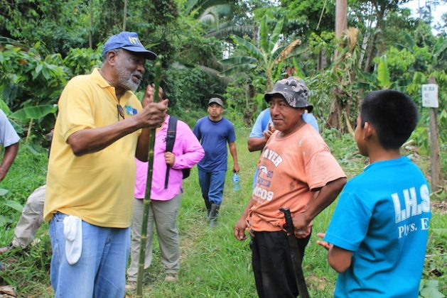 Deputy Director at the Caribbean Community Climate Change Centre Dr. Ultic Trotz (left) in conversation with farmers at a unique agroforestry project in Belize, one of many implemented by the Centre to boost the region's resilience to the effects of climate change. Credit: Zadie Neufville