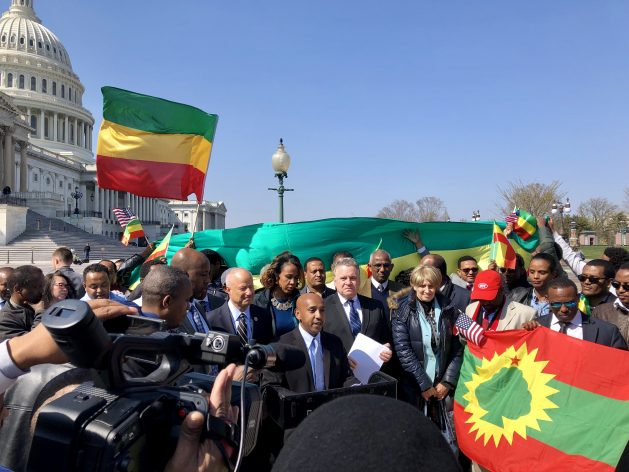 Tewodrose Tirfe, chair of the Amhara Association of America, addresses press and supporters outside Washington's Capitol Building after passage of House Resolution-128. Behind and to his left is Congressman Chris Smith and behind and to his right is Congressman Mike Coffman, both of whom played key roles in the resolution's successful passage. Photo courtesy Tewodrose Tirfe/Congressman Mike Coffman's office.