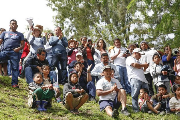 Indigenous children from the mountains of Oaxaca, in the southwest of Mexico listen in the town of Guelatao to the education reform proposal of Andrés Manuel López Obrador, the presidential frontrunner according to the polls, who announced that, if he wins, he will institute bilingual schools in the indigenous regions. Credit: Danilo Rodríguez / IPS