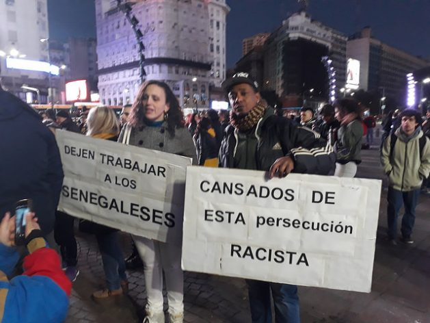 "Police brutality against Senegalese street vendors in recent months has outraged Argentines and immigrants who demonstrated on Jun. 16 in Buenos Aires, carrying signs reading ""Let the Senegalese work"" and ""Fed up with racist persecution"". Credit: Daniel Gutman/IPS"