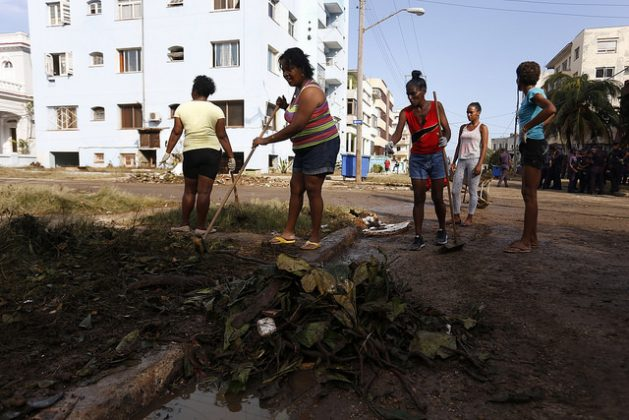 A group of women clean a street after the passage of Hurricane Irma, in the Havana neighborhood of Vedado in September 2017. Women play a leading role in mitigating the impacts of climate change, a phenomenon to which they are also the most vulnerable. Credit: Jorge Luis Baños/IPS