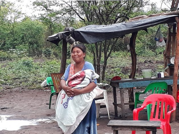 A Wichí woman holds her baby in her arms in a community of this indigenous people in the northern Argentine province of Salta, in the Chaco ecoregion, where poverty levels are high. She is an illustration of the poverty in which 59 million people live in Latin America's rural areas, 48.6 percent of the total rural population. Credit: Daniel Gutman/IPS