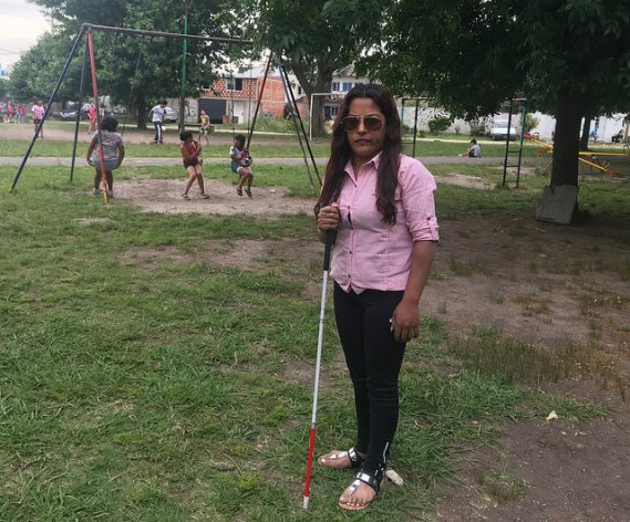Susana Gómez, who was left blind by a beating from her then husband, says in a park in the city of La Plata, Argentina that she did not find support from the authorities to free herself from domestic violence, but a social organisation saved her from joining the list of femicides in Latin America - gender-based murders of women, which numbered 2,795 in 2017 in the region. Credit: Fabiana Frayssinet/IPS