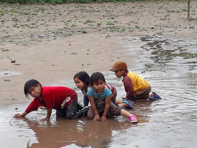 A group of Wichí children play in the mud in the indigenous community of El Quebracho, in northern Argentina. This country's laws recognise the right to bilingual support in the education of native children, but in practice the rule is not enforced and children suffer discrimination when they speak their native languages. Credit: Daniel Gutman/IPS