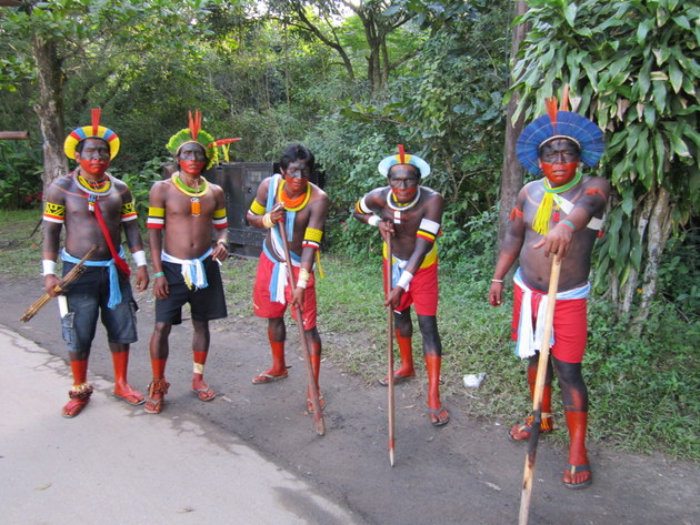 Karioca Cupobo Indians are painted and armed for combat before participating in a demonstration for indigenous rights in Rio de Janeiro, Brazil. Credit: Mario Osava/IPS
