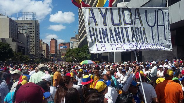 """""""Humanitarian aid now. We need it,"""" read a banner during a massive demonstration in Caracas on Feb. 12, demanding that international aid blocked at the border of neighboring countries be allowed into the country. The demonstrations were held in 50 towns and cities around the country, in support of Juan Guaidó as acting president and demanding that President Nicolás Maduro step down. Credit: Humberto Márquez/IPS"""