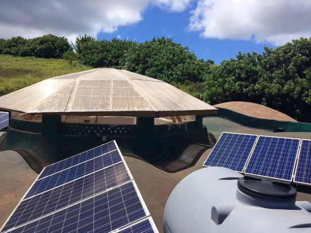 The roof of the original headquarters of the Toki Foundation on Easter Island, or Rapa Nui, located 3,800 kilometers from the Chilean coast, is also used to collect rainwater, which runs into eight large storage ponds, and to generate electricity by means of 18 solar panels. Credit: Orlando Milesi/IPS