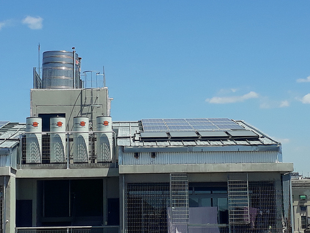 A total of 174 solar panels and 55 solar-powered water heaters were installed on the rooftops of the new social housing complex in Villa 31, in the Argentine capital. Each water heater has a capacity of 300 liters and supplies two homes, based on the estimate of an average of three people per apartment, who use 50 litres of hot water a day. Credit: Daniel Gutman/IPS