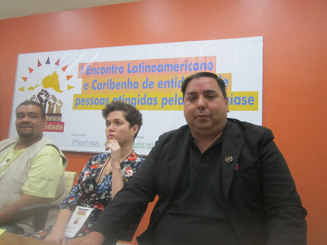 Brazilian activists José Picanço (front) and Evelyne Leandro testified about how Hansen's disease affected them during a Latin American and Caribbean meeting in Rio de Janeiro. Picanço was separated from his parents when they were diagnosed with leprosy when he was born in 1972 and was only reunited with them eight years later, shortly before his mother died. Leandro wrote a book about the difficulties of being diagnosed with the disease in Germany, where she lives. Credit: Mario Osava/IPS