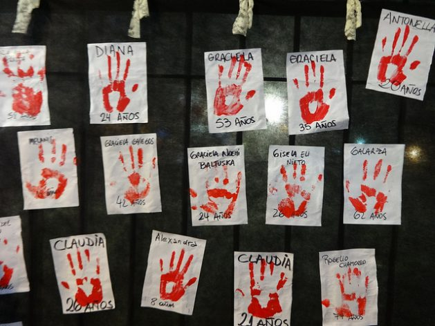 Part of a mural of bloody handprints, with the names of some of the women victims of femicide, during a demonstration in the Argentine capital held under the slogan #NiUnaMenos (Not One Woman Less). In Latin American societies, awareness of gender-based murders is growing, while new measures are being promoted to curb them. Credit: Fabiana Frayssinet/IPS