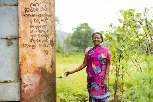 A woman collects the drinking water from the third tap in Simlipadar village in Thuamul Rampur, Kalahandi   Picture courtesy: Ajaya Behera