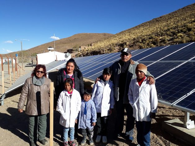 Residents of San Francisco, a community of just 54 people in Argentina's Puna region, stand next to solar panels that began to operate in early October, supplying all their electricity and providing them with street lighting for the first time. It is the fourth completely solar town in the province of Jujuy, on the border with Bolivia and Chile. Credit: Daniel Gutman/IPS
