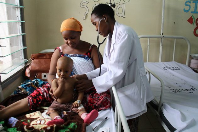 An eight-month-old boy is examined by a doctor in Dar es Salaam, Tanzania. Credit: Kristin Palitza/IPS