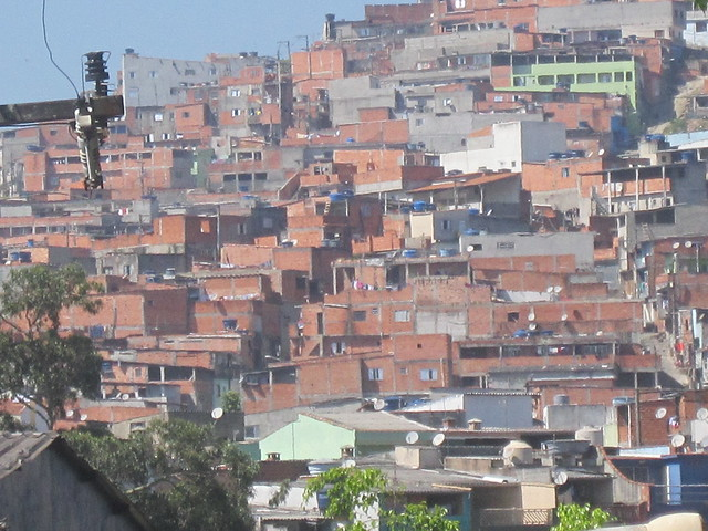 A view of a favela in São Bernardo do Campo, an industrial city near the metropolis of São Paulo in southern Brazil. The idea was that shantytowns in Brazil and other countries of the developing South would be easy prey to the COVID-19 pandemic because of overcrowding, but this has not been the case. There are populous slums in Brazil and other countries that have had few cases .CREDIT: Mario Osava/IPS