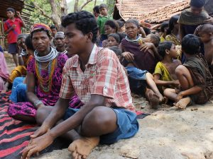 In this photo dated 2014, Buda Kirsani of the Bonda tribe tells IPS how he had to walk 12 kilometres across hill ranges, navigating steep hills to get to his classroom everyday. He dropped out in fifth grade and took admission in the local tribal residential school that the Odisha government opened for children like him. Current school closures because of coronavirus has sent thousands such disadvantaged children home uncertain if they will return to schooling anytime soon. Credit: Manipadma Jena/IPS
