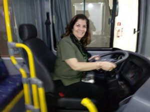 Iêda de Oliveira sits at the wheel of one of the buses manufactured by the company she heads, Eletra, a pioneer in electric and hybrid buses in Brazil. She regrets that Brazil, due to a lack of adequate public policies, has lost the foreign market for buses and part of the domestic market to China, after having been a major exporter of buses to Latin America and other regions. CREDIT: Courtesy of Eletra