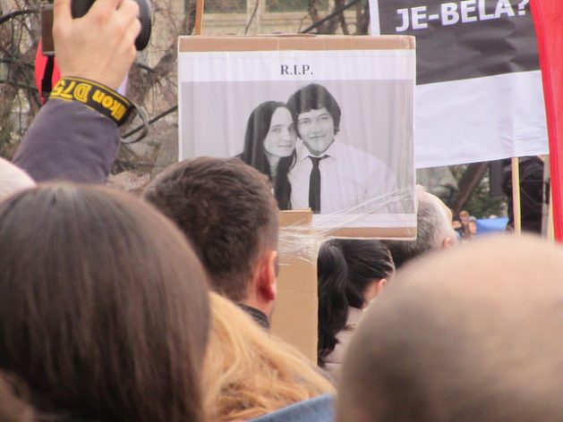 Experts say that the not guilty verdict in the trial of the murder of investigative journalist Jan Kuciak sends a chilling message to Slovak journalists that they cannot be protected or work in safety. In this dated photo, a protester in the Slovak capital, Bratislava holds up a picture of murdered journalist Kuciak and his fiancée Martina Kusnirova. Credit: Ed Holt/IPS