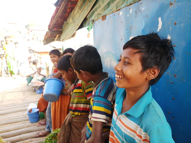 Mohammad Rafique, along with other refugee children, gathered at the Rohingya market of Kutupalong camp to sell vegetables he brought earlier from a local market in this photo dated Mar. 11, 2020. This was two weeks before Bangladesh went into a nationwide lockdown in an attempt to contain the spread of the coronavirus. the pandemic is leading to a global child rights crisis with increases in poverty and hunger, child labour and child marriage, child slavery, child trafficking and children on the move. Credit: Rafiqul Islam/IPS