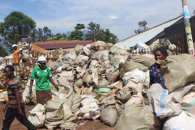 Women in eastern Uganda's Mbale city collect plastic waste for recycling. Proponents of upcycling say that in recycling waste one ends up polluting the environment. Credit: Wambi Michael/IPS