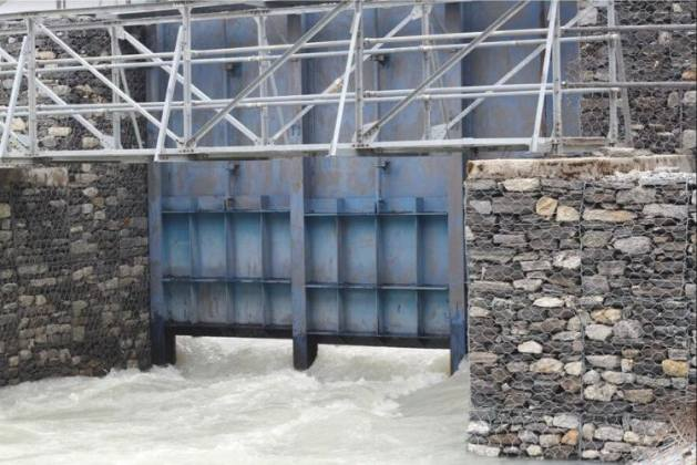 A sluice gate built 20 years ago reduced the level of the water by 3m, but it needs to go down by 20m to reduce the danger of a Glacial Lake Outburst Flood (GLOF). Credit: RASTRARAJ BHANDARI