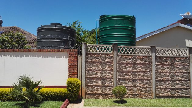 Water tanks installed in homes in a Bulawayo suburb. The city has been facing a decades long water crisis. Credit: Ignatius Banda/IPS
