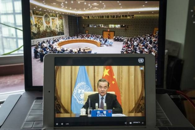 """Wang Yi, Minister for Foreign Affairs of the People's Republic of China, addresses the virtual Security Council summit-level debate on """"Maintenance of International Peace and Security: Global Governance post Covid-19"""". Credit: UN Photo/Loey Felipe."""