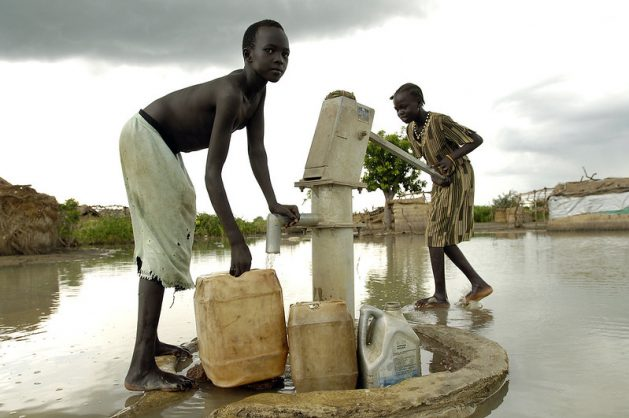 Sudan, the largest country in Africa, is most vulnerable to climate variability and change with drought and flooding being the biggest climate challenges. This dated photo show displaced children fetching water following 2008 floods in Sudan. Courtesy: UN Photo/Tim McKulka