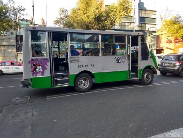 """I use gas"", announces a minibus driving along a street in Mexico City. Natural gas is becoming increasingly widely used as fuel for public transportation in Mexico, coming mainly from the United States where it is extracted through hydraulic fracturing or fracking, a technique that requires high volumes of water and toxic chemicals. CREDIT: Emilio Godoy/IPS"