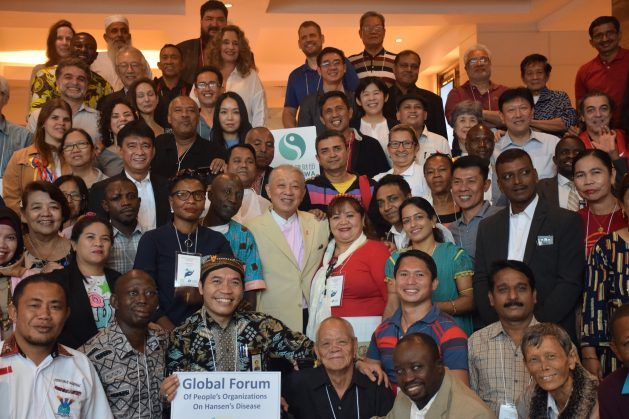 Participants from organisations focused on assisting Hansen's disease-affected people from Asia, Latin America and Africa with World Health Organisation (WHO) Goodwill Ambassador for Leprosy Elimination, Yohei Sasakawa (centre pink shirt) pictured in 2019. Participants were attending the Global Forum of People's Organisations on Hansen's disease in Manila, Philippines, which was sponsored by the Sasakawa Health Foundation and The Nippon Foundation. Credit: Stella Paul/IPS