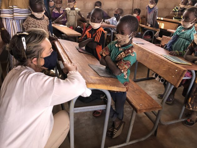 Education Cannot Wait (ECW) Director Yasmine Sherif speaks to crisis-affected children in Burkina Faso. ECW has launched a multi-year programme in the country, providing $11 million in funding, but a further $48 million is needed. Courtesy: Education Cannot Wait (ECW)