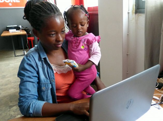 Marcia Julio Vilanculos, pictured here in this dated photo with her baby, was one of the participants of a digital literacy training course at Ideario innovation hub, Maputo, Mozambique a few years ago. Only 6.8 percent of all Mozambican women, with or without owning a cellphone, use the internet. Questions remain about the possibility of a successful transition to a digital economy in a world where there's a glaring digital divide -- one that has become even more pronounced under the pandemic. Credit: Mercedes Sayagues/IPS