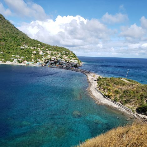 A peninsula separates the Atlantic Ocean and Caribbean Sea in the southwestern village of Scottshead, Dominica. Dominica banned single use plastic in 2020. The UN Decade on Ocean Science is calling for amped up action on conservation and the sustainable use of ocean resources. Credit: Alison Kentish/IPS