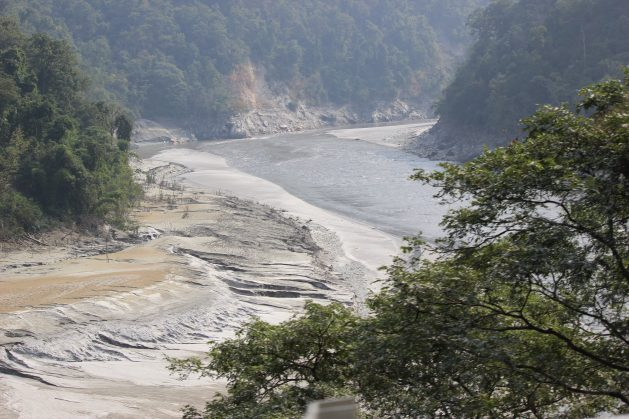 """Studies show that glaciers in India are permanently losing ice, not only owing to higher temperatures from global warming but also in response to """"deprived precipitation conditions"""" High siltation as the Teesta, a Himalayan glacier-sourced river which rises from the Eastern Himalayas, is dammed at the Teesta barrage at Siliguri, West Bengal. Credit: Manipadma Jena/IPS"""