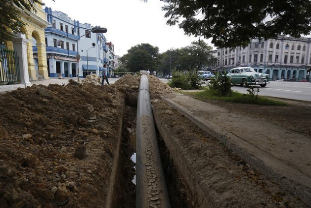 High-density polyethylene pipe is laid on a street in the Cuban capital, where the Aguas de La Habana water company is upgrading the water supply networks in the municipality of Centro Habana. CREDIT: Jorge Luis Baños/IPS