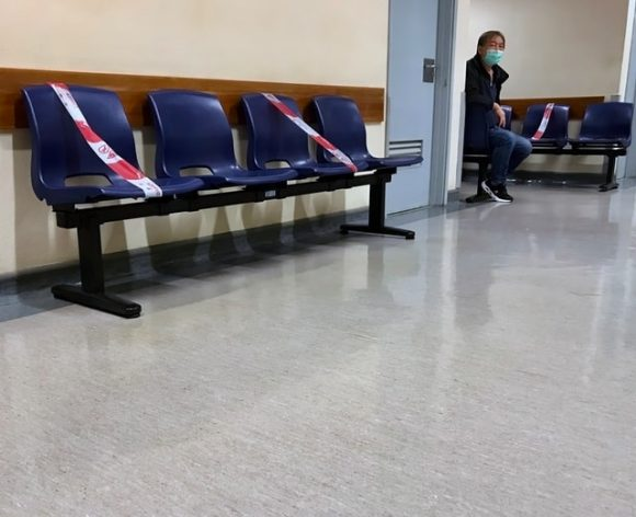 Social distancing in a Macau Hospital waiting room. Reporters Without Borders (RSF) said censorship of the Chinese media made the COVID-19 situation worse. Photo by Macau Photo Agency on Unsplash
