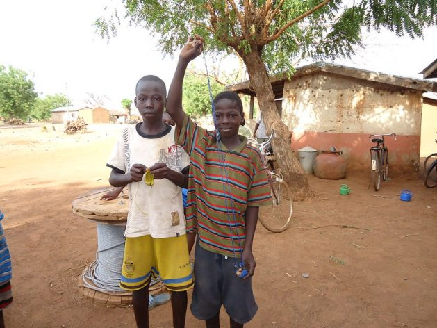 Musah Razark Adams, 13, (r) shows the sling shot that he uses to hit birds with when he works in a local rice field. Adams and his brother, Seidu, 15, (l) work to so that they can pay for school materials. A new report on child labour shows that global progress against child labour has ground to a halt and that a further 8.9 million children will be in child labour by the end of 2022 as a result of rising poverty driven by the COVID-19 pandemic. Credit: Albert Oppong-Ansah/IPS