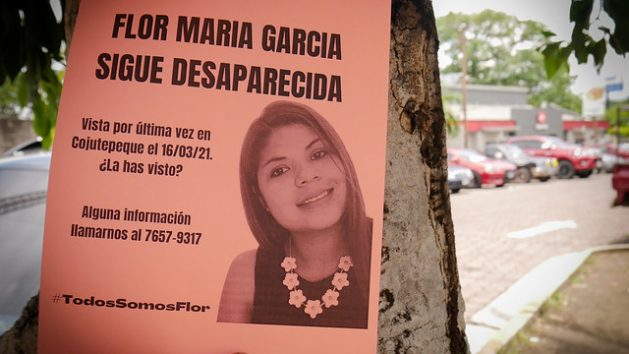 One of the flyers pasted on a tree in the city of Sonsonate, in eastern El Salvador, which on Jun. 28 called for help to find Flor Maria Garcia, 33, missing since March. The next day, the young woman's body was found in a vacant lot near Cojutepeque, the city in the centre of the country where she lived with her husband, Joel Valle, arrested as the main suspect in the case of femicide. CREDIT: Edgardo Ayala/IPS