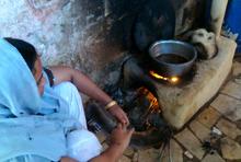 Roma Juma makes tea for guests using her smoke-free stove. Credit: Zofeen Ebrahim/IPS