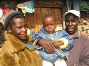 HIV-positive couple Miriam Wanjiru (l) and Samuel Mwangi (r) with their two-year-old HIV-negative son.  Credit: Isaiah Esipisu/IPS