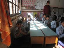 Grade 2 students of Shree Saraswati Secondary School praying at the start of the school day. Credit: Damakant Jayshi/IPS