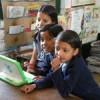 Girls share a 100-dollar laptop. Credit: Komathi A.L.