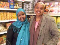 Saido Farah (L) and Deeqo Jibril (R) inside Farah's business, Roots Halal Meat Market. Credit: Talia Whyte/IPS