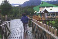 A resident of Caleta de Tortel on one of the town's distinctive wooden walkways.  Credit: Susana Segovia/IPS