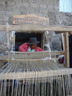 Vilma Matías weaving on a loom at the Lucanamarca workshop. Credit: Milagro Salazar/IPS