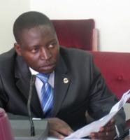 David Bahati submitting his controversial anti-gay Bill to parliament.  Credit: Wambi Michael/IPS
