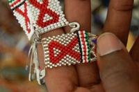 A hand woven tag bearing the HIV symbol on sale at the Sokoni Market in Nairobi, Kenya. Credit: Allan Gichigi/IRIN