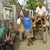 Unemployed youths in Sierra Leone sometimes find work pushing wooden carts for merchants. Credit: Ansu Konneh/IRIN