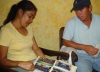 Rosmery González's parents look at photos of their murdered daughter.  Credit: Danilo Valladares/IPS