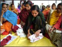 Teaching women in Muzaffarpur, Bihar state, to make sanitary napkins Credit: Goonj